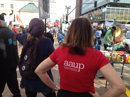Balliger represents AAUP at International Workers Day in Oakland, May 1, 2018, in red union shirt