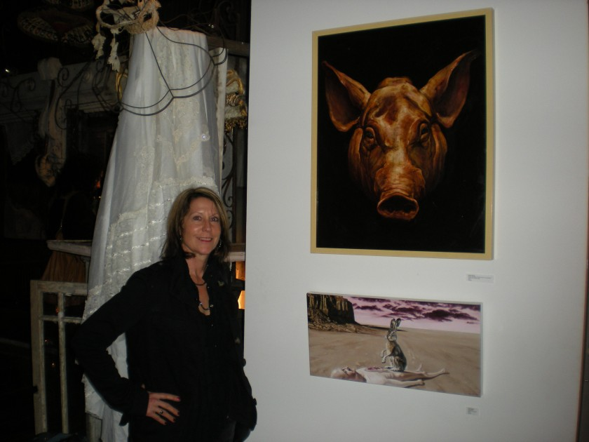 Balliger at multi-species art show, American Anthropological Association conference, New Orleans, 2010, with paintings of pig portrait and rabbit