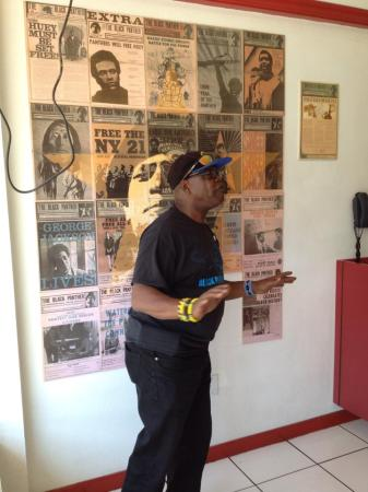 Billy X explains significance of Black Panthers in front of historical posters