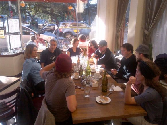 David Graeber discusses with SFAI faculty and students, sitting around restaurant table