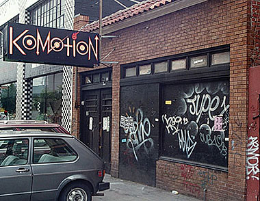 Front door of Komotion at 2779 16th Street, San Francisco, full of graffiti