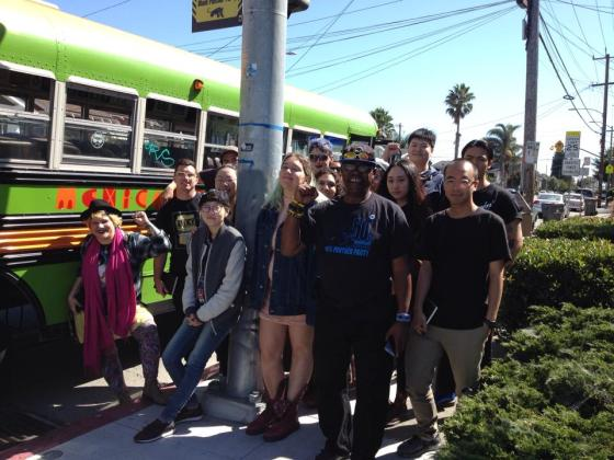 Students in Balliger's Oakland class with Billy X and colorful Mexican bus